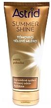 Düfte, Parfümerie und Kosmetik Getönte Körperlotion mit Kakao- und Sheabutter für helle Haut - Astrid Summer Shine